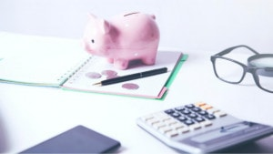 piggy bank notepad and calculator